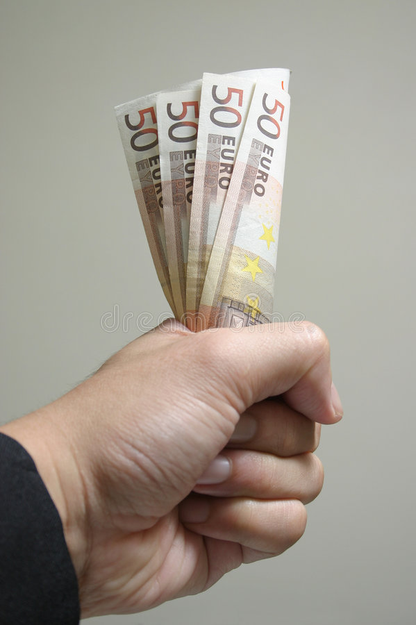 De clutching Euro van de hand stock foto's
