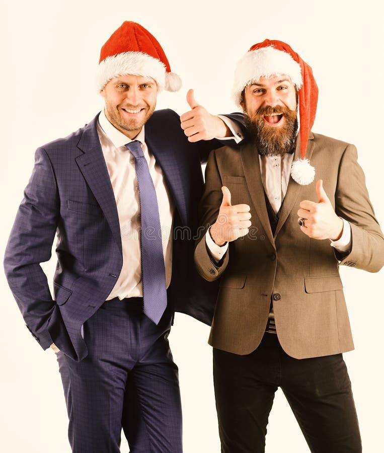 De collega's met baarden hebben Kerstmisvergadering Mensen in klassieke kostuums stock fotografie