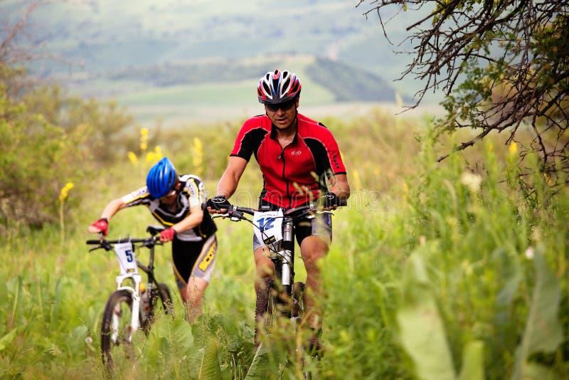 De concurrentie van de de bergfiets van de zomer stock foto's