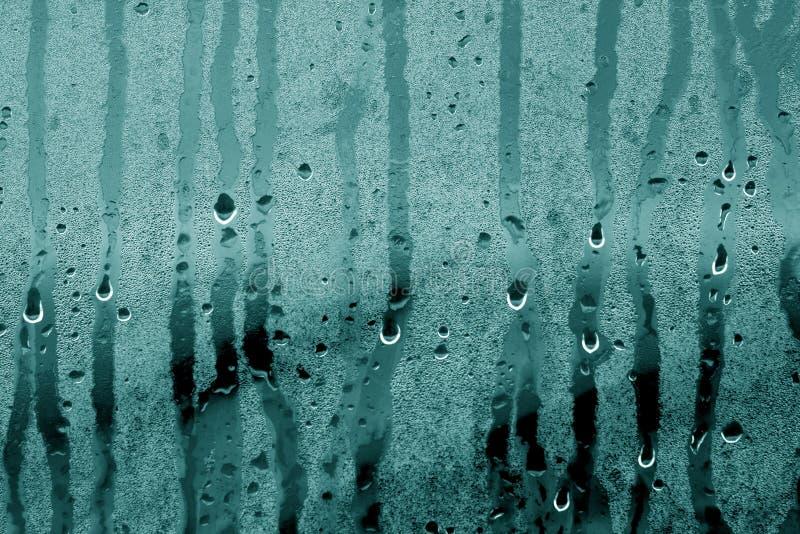 De condensatie daalt dicht omhoog in cyaantoon stock foto