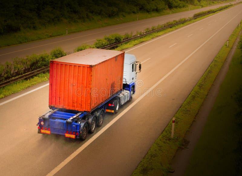 De containervrachtwagen stock afbeeldingen