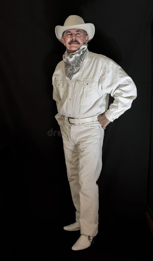 De cowboy met snor in een witte hoed stock afbeelding