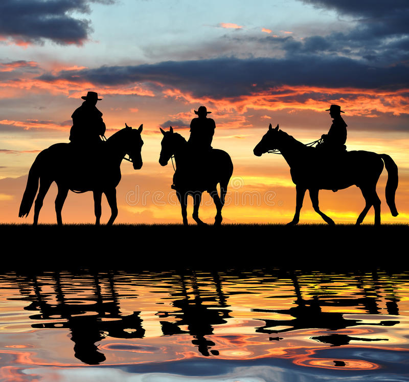 De cowboys van het silhouet stock fotografie