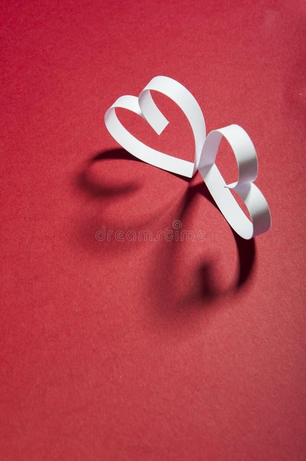 De Dag rode achtergrond van Valentine ` s en Witboekharten royalty-vrije stock fotografie