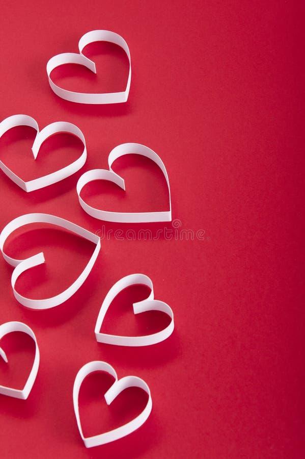 De Dag rode achtergrond van Valentine ` s en Witboekharten royalty-vrije stock foto