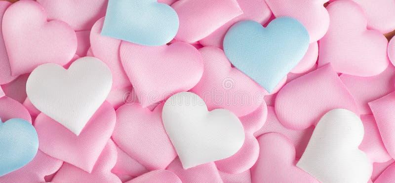 De dag van de valentijnskaart `s De roze achtergrond van de hartvorm Abstracte Valentine-achtergrond met de roze, witte en blauwe stock fotografie