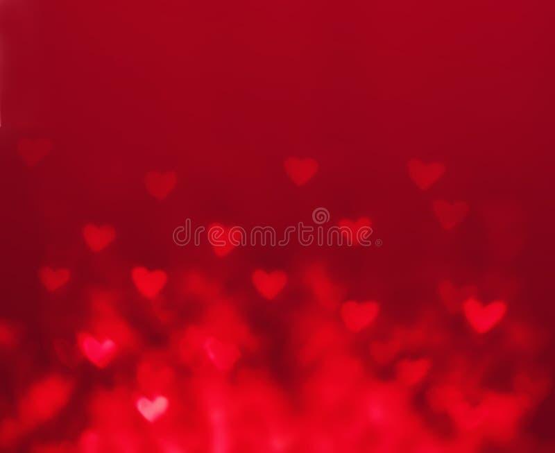De dagachtergrond van abstract Valentine met rode harten Gloed Colorf royalty-vrije stock afbeeldingen