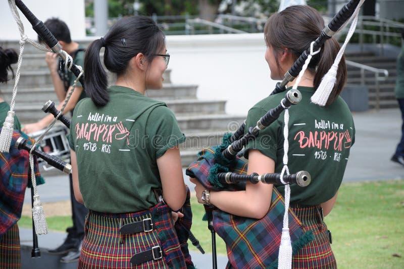 De Dagbagpiper van heilige Patrick ` s de meisjes van de muziekband stock fotografie