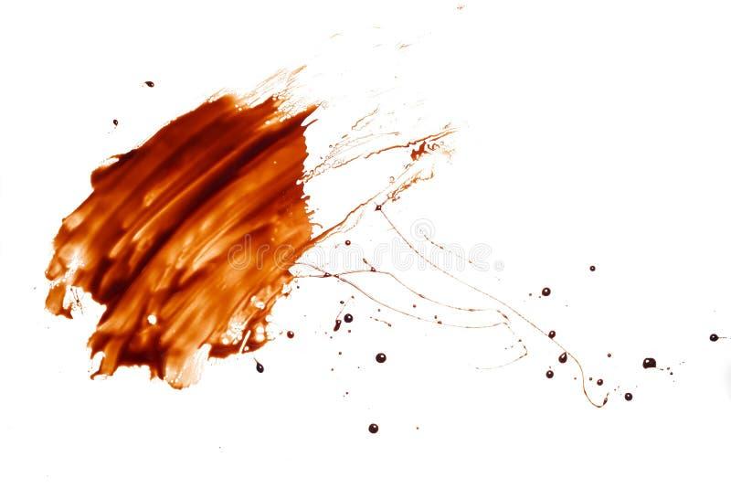 De dalings vloeibare witte achtergrond van de chocoladeplons royalty-vrije stock fotografie