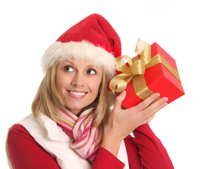 De dame van de kerstman en de gift stock afbeelding