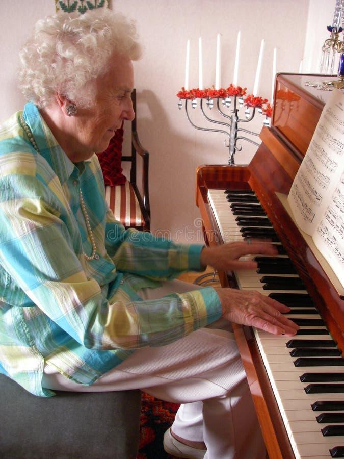 De Dame van de piano stock afbeeldingen