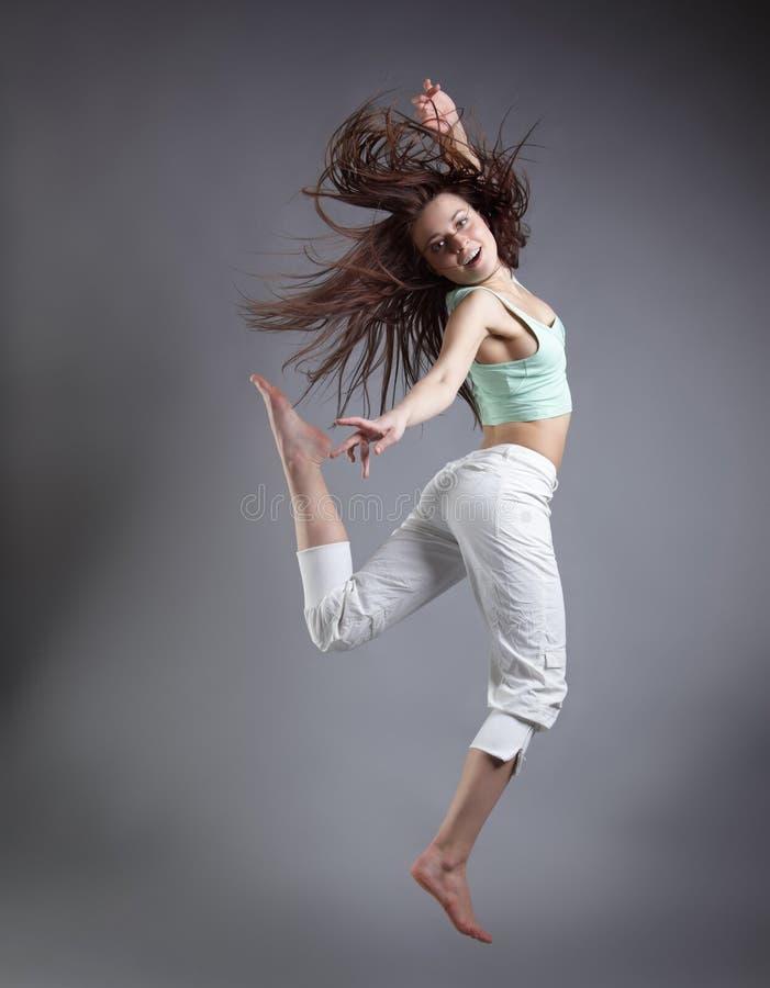 De dans van het schoonheidsmeisje stock afbeelding