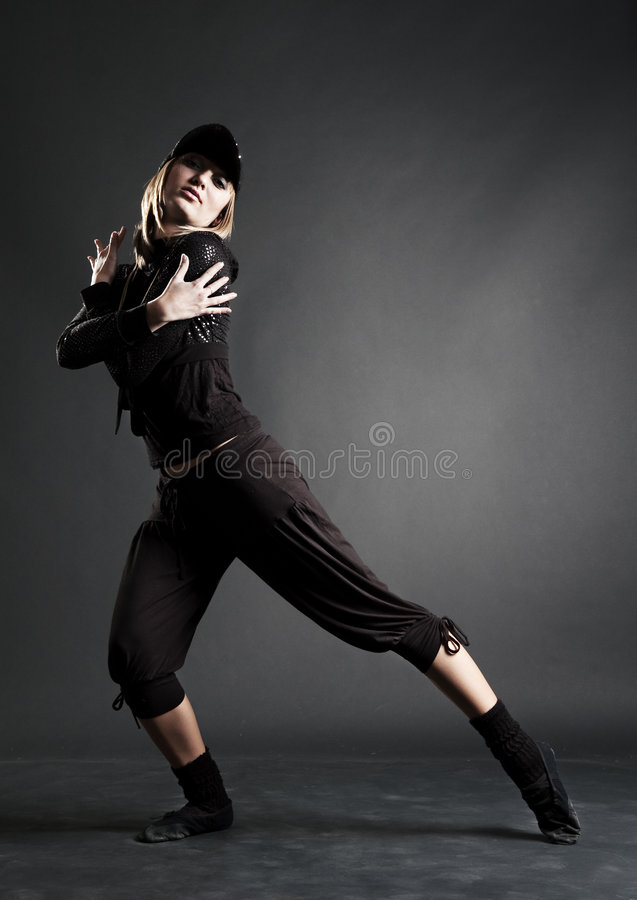 De danser van de hartstocht in zwarte kleren royalty-vrije stock fotografie