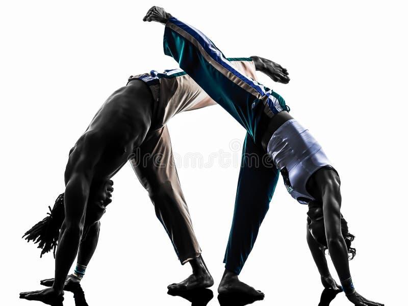 De dansers van paarcapoeira het dansen   silhouet stock afbeelding