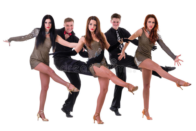 De dansersteam van het cabaret het dansen Geïsoleerd op witte achtergrond in volledige lengte stock foto