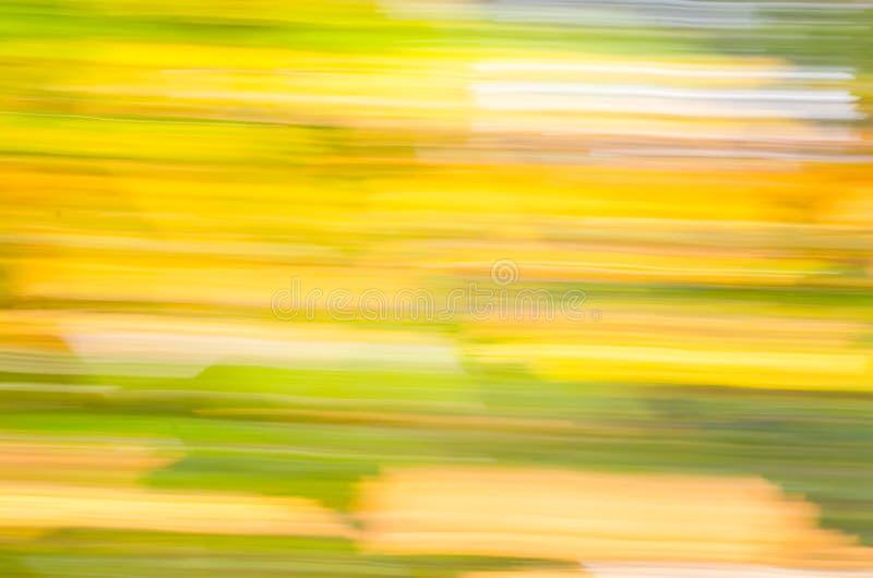 De de herfstmotie blured achtergrond royalty-vrije stock foto