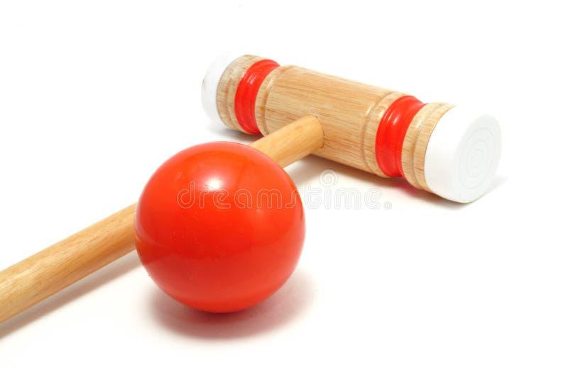 De de oranje Houten hamer en Bal van het Croquet stock foto's