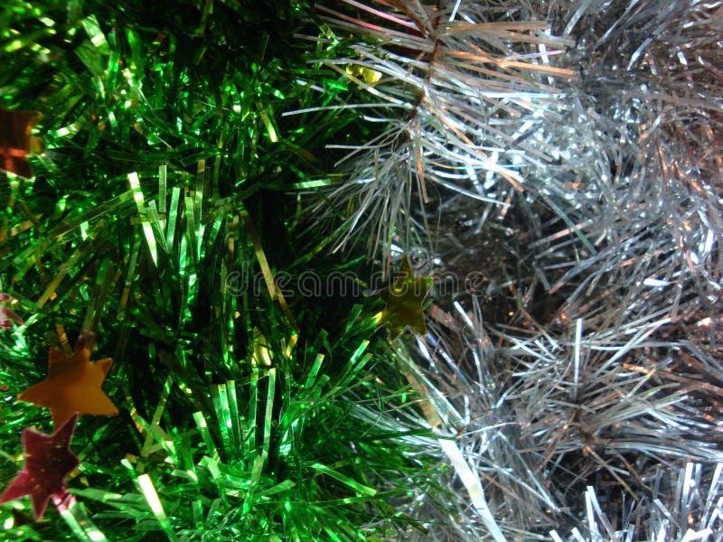 De decoratie van het Kerstmisklatergoud voor een feestelijk achtergrond of een Nieuwjaar Witte geelgroen en roze stock afbeelding