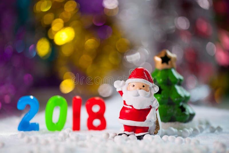 De decoratie van Kerstmissteunen op het gebiedsachtergrond w van de Kerstmissneeuw stock foto
