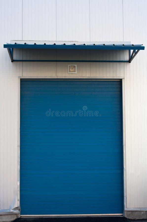 De deur van het pakhuis royalty-vrije stock afbeeldingen