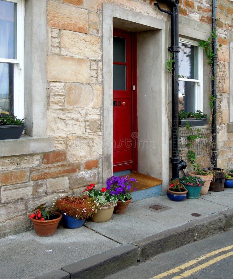De deuropening van het dorpshuis royalty-vrije stock afbeeldingen
