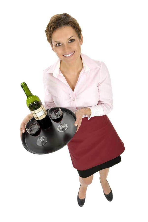 De Dienende Wijn van de serveerster stock foto