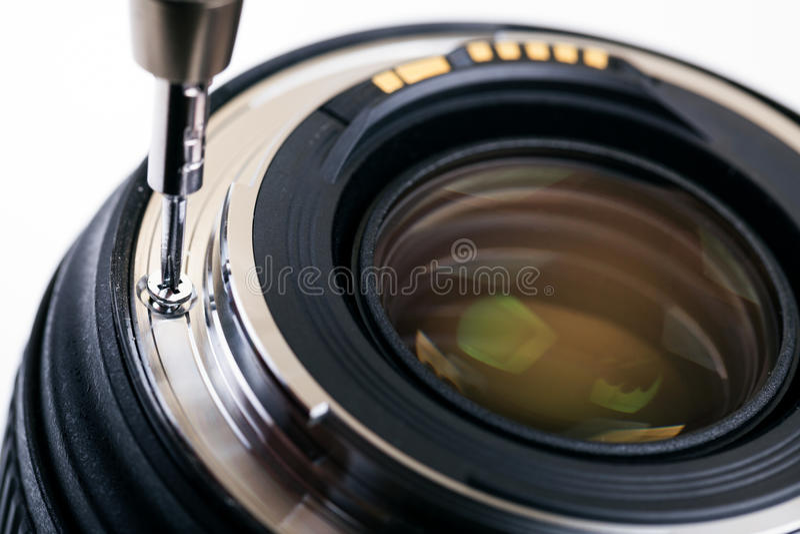 De dienst van het fotomateriaal, demonterende cameralens royalty-vrije stock afbeelding