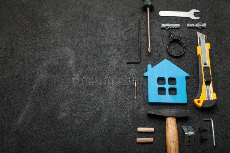 De dienst van de huisreparatie, de abstracte hardwarebouw Bouw creatief concept Exemplaarruimte voor tekst stock foto