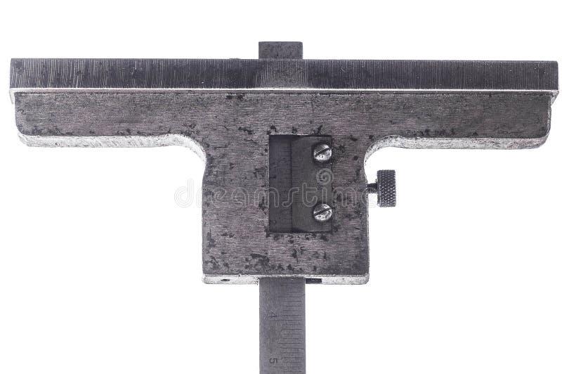 De dieptemaat voor het meten van de hoogte holten op een witte achtergrond isoleert stock afbeeldingen