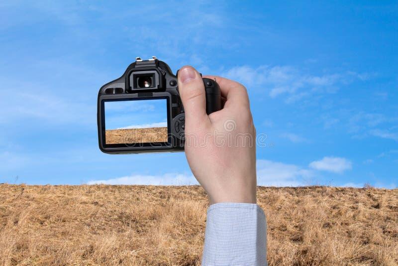 De digitale camera in een hand stock foto