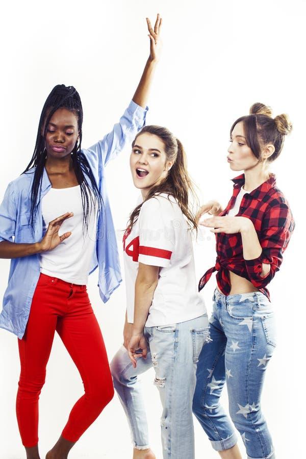 De diverse multinatiemeisjes groeperen zich, tiener vrolijk vriendenbedrijf die pret hebben, het gelukkige glimlachen, het leuke  royalty-vrije stock afbeelding