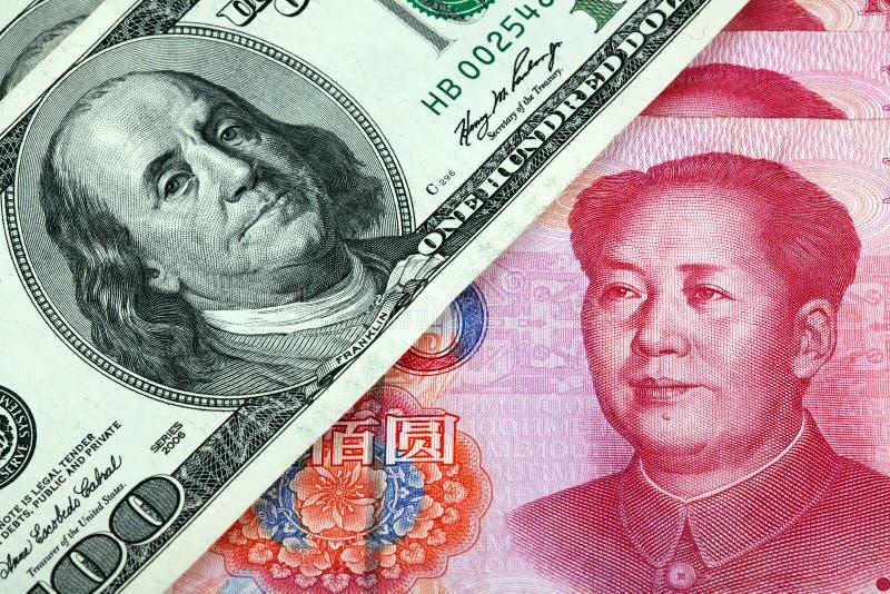 De dollar van de V.S. en Chinese yuan stock afbeelding