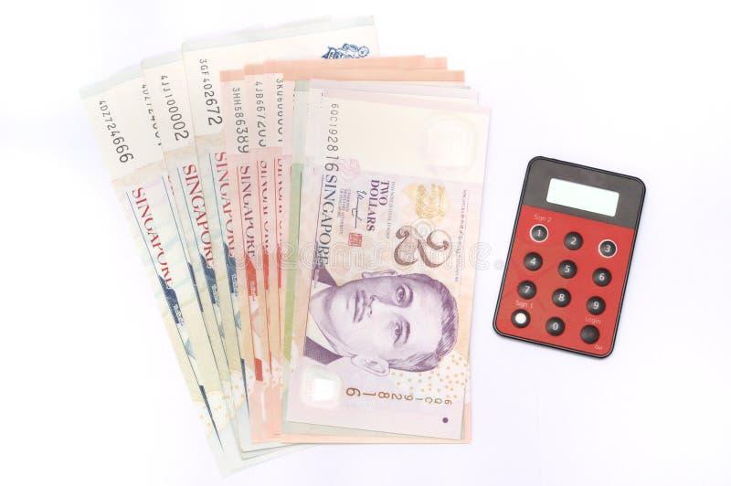 De dollarnota's van Singapore met een Internet-bankwezenapparaat stock foto