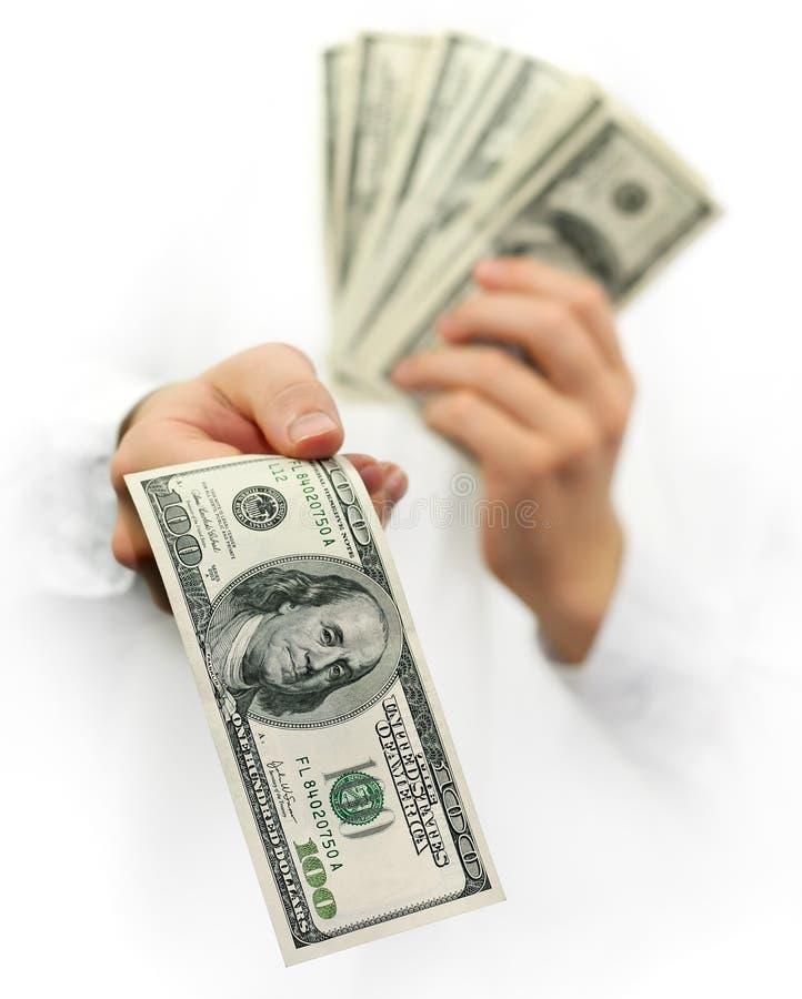 De dollars van het geld in de geïsoleerdeo handen stock foto