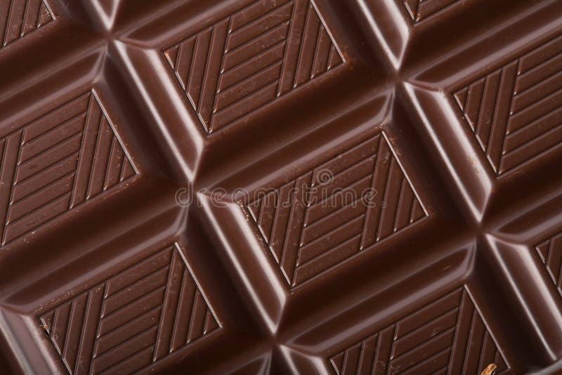 De donkere achtergrond van het chocoladeblok royalty-vrije stock afbeelding