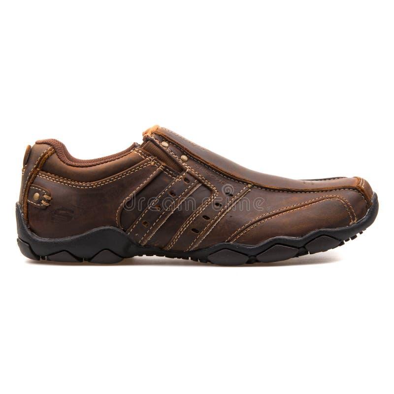 De donkere bruine tennisschoen van de Skechersdiameter stock fotografie