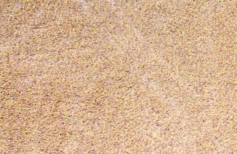 De donkere en lichtbruine achtergrond van de tapijttextuur stock afbeeldingen