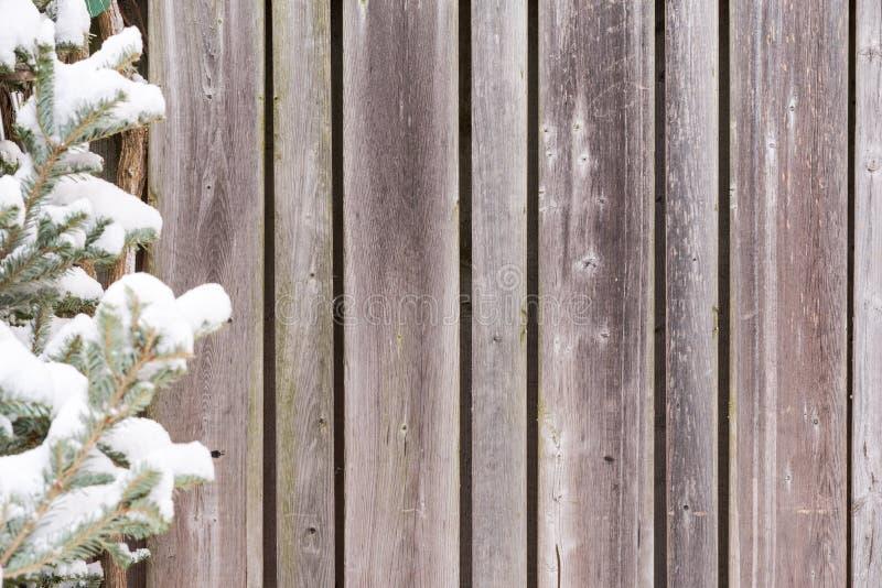 De doorstane houten achtergrond van de omheiningswinter stock fotografie