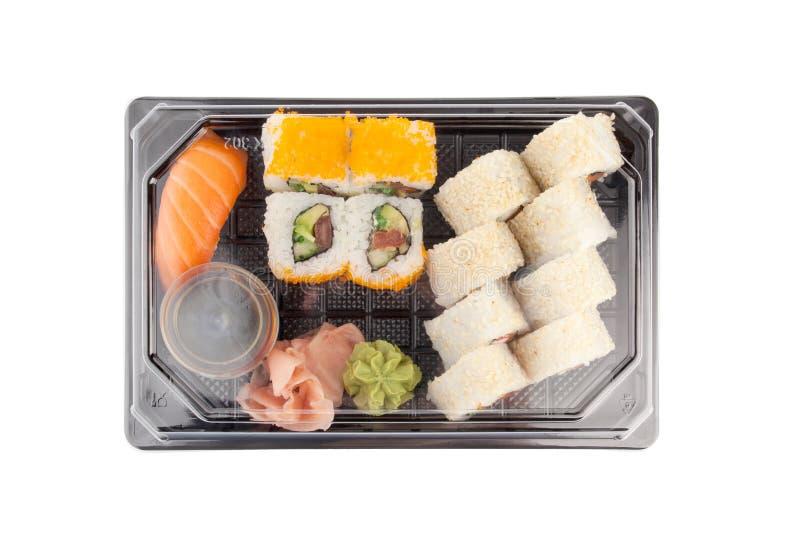De doos van de sushilevering op witte achtergrond Het menu van Japan in zwarte vervoerdoos stock afbeeldingen