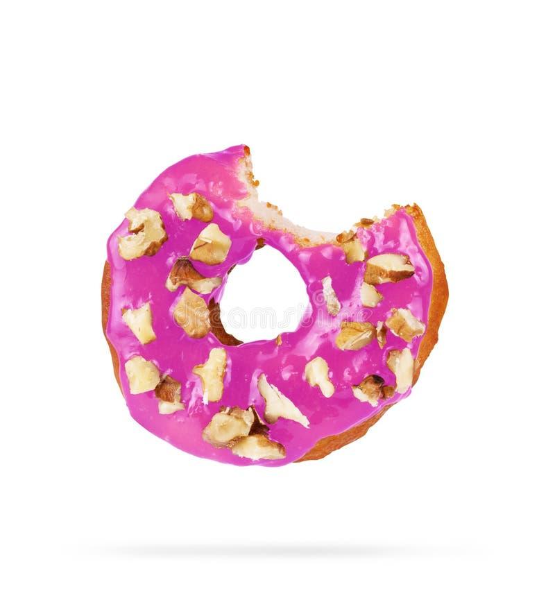 De doughnut is gebeten op een witte achtergrond royalty-vrije stock fotografie