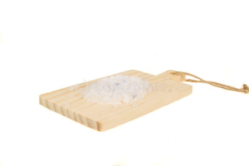 De draagstoel van de siliconekat in massa op houten scherpe die raad op witte achtergrond wordt geïsoleerd stock afbeeldingen
