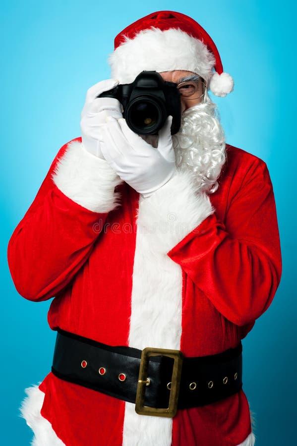 De draaien van de Kerstman in een profotograaf royalty-vrije stock foto
