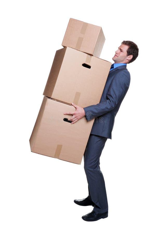 De dragende dozen van de zakenman stock afbeelding
