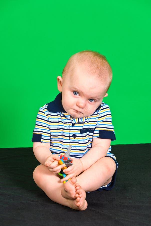 De droevige Jongen van de 10 Maand oude Baby op het Groene Scherm royalty-vrije stock afbeeldingen