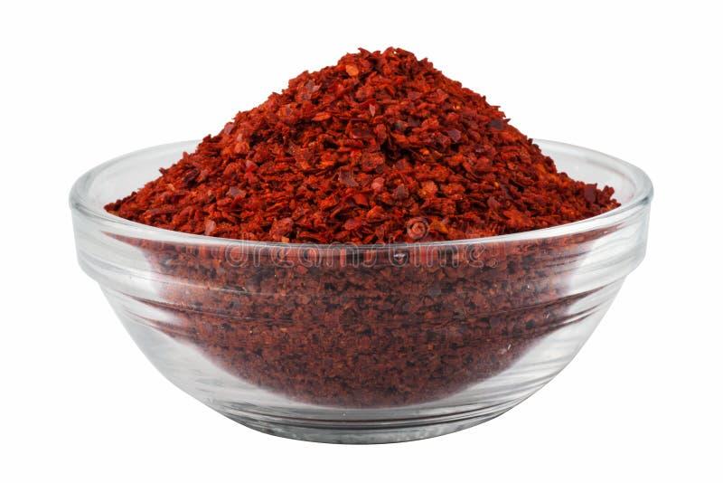 De droge die Spaanse peper, Spaanse pepers schilfert in een kom af, op witte achtergrond wordt geïsoleerd stock foto