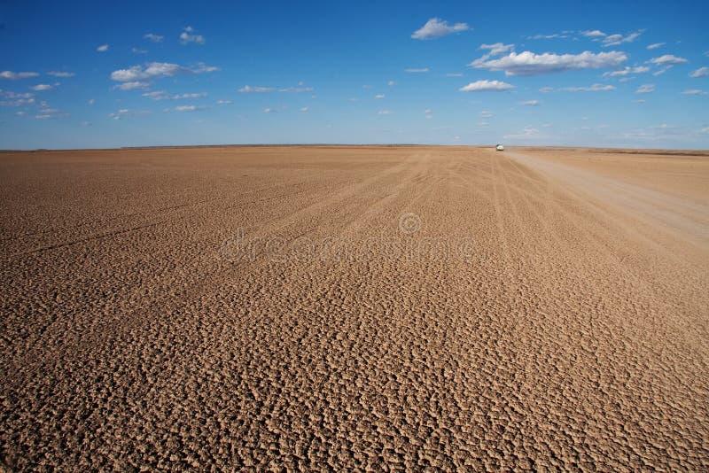 De droge pan van de woestijn stock afbeeldingen