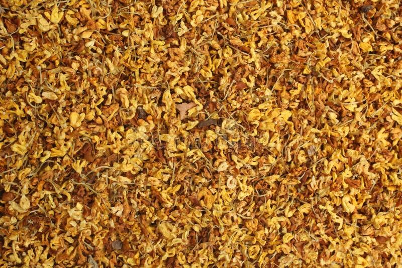 De droge thee van osmanthusbloemen, voor achtergronden of texturen royalty-vrije stock foto