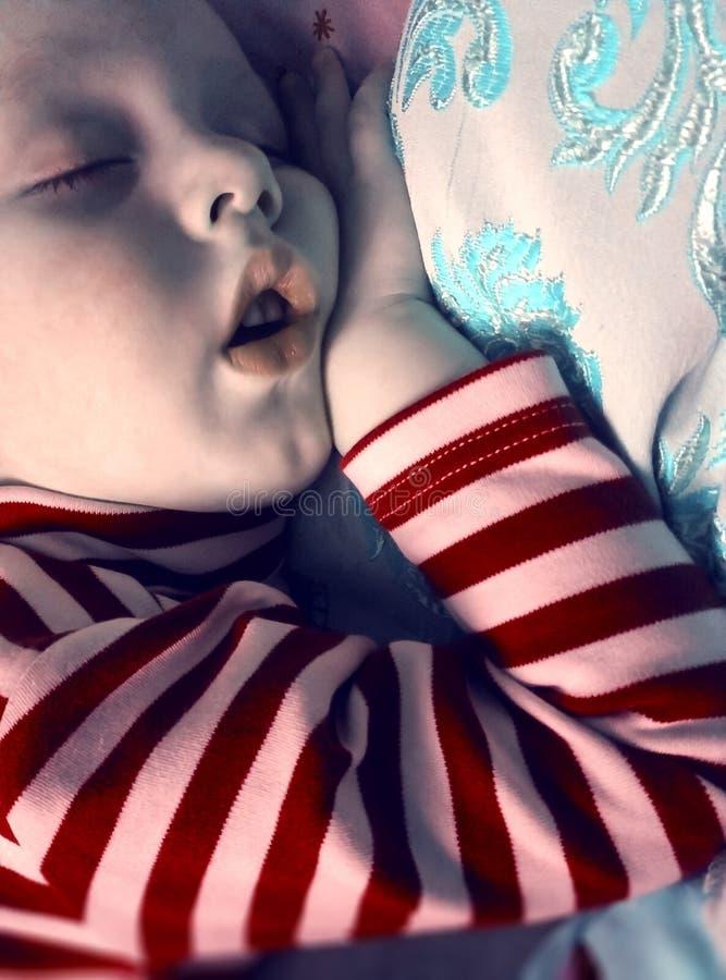 De droom van de lieflijke baby royalty-vrije stock afbeeldingen