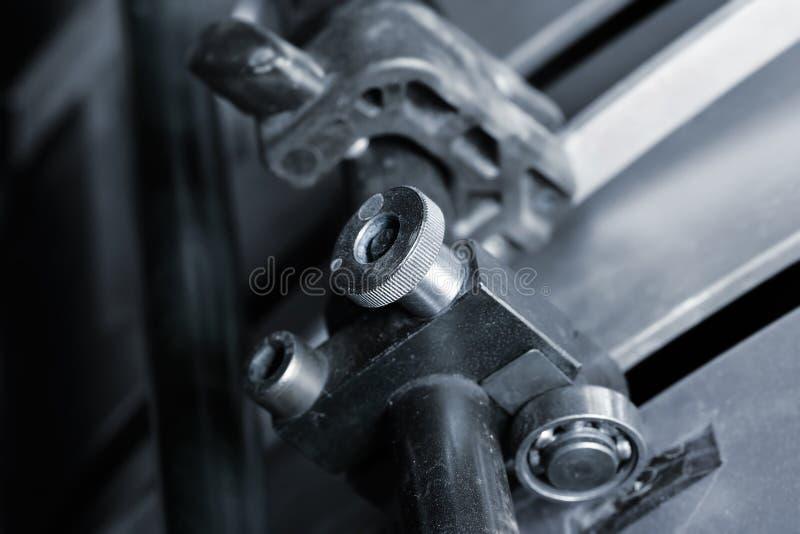 De drukmachine van de hulpmiddelencompensatie stock afbeeldingen