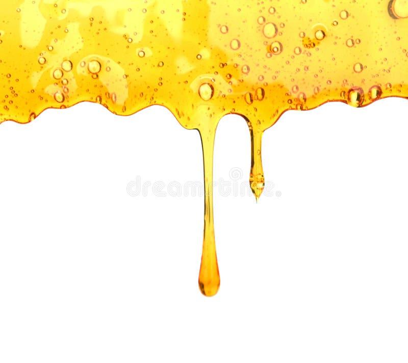 De druppel van de honing van lepel royalty-vrije stock foto